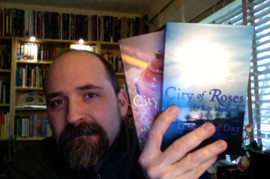 The author, with two of his books.